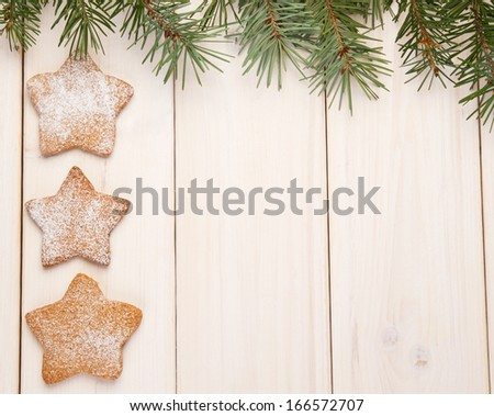 Christmas gingerbread cookies on white wooden background - stock photo