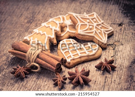 Christmas gingerbread cookies on wood background. Toned image - stock photo