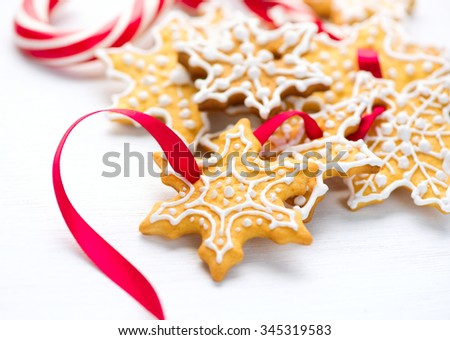 Christmas Gingerbread Homemade Cookies and Candy Canes over wooden table background. Traditional Holiday Sweets - stock photo