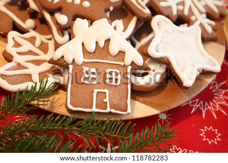 Christmas gingerbread house and cookies decorated with icing. - stock photo