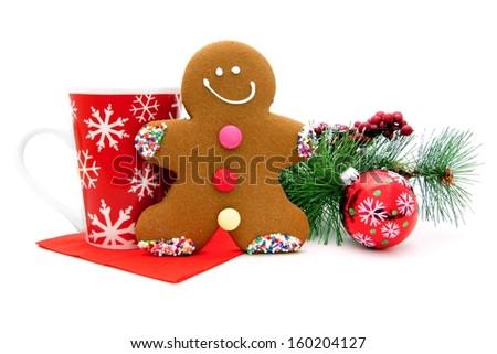 Christmas gingerbread man with festive mug and decor - stock photo