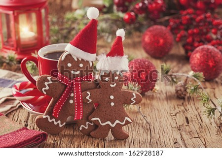 Christmas gingerbread men and hot drink - stock photo