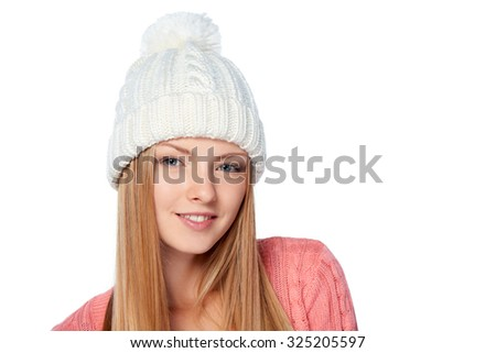 Christmas girl, Closeup portrait of young beautiful smiling woman wearing warm winter clothing, over white background - stock photo