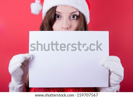 Christmas girl in santa hat holding banner. Isolated. - stock photo