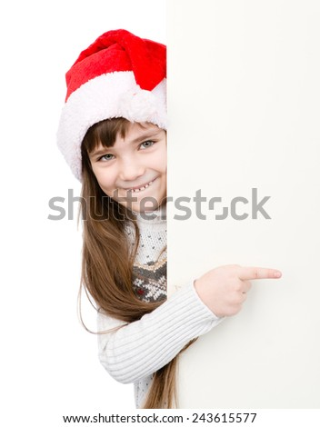 Christmas girl in santa helper hat pointing on blank white board. isolated on white background - stock photo