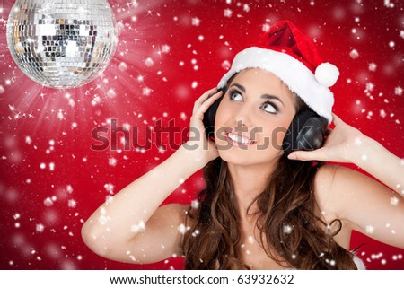 Christmas girl with disco ball listening music while snowing - stock photo