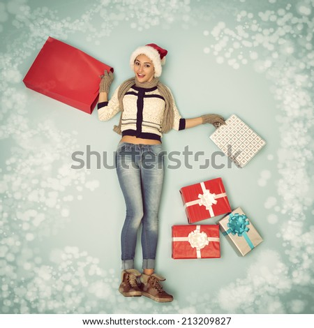 Christmas girl with gift and shopping bags in snowflakes - stock photo