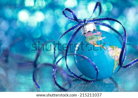 Christmas Globe in de-focused blue lights background.  - stock photo
