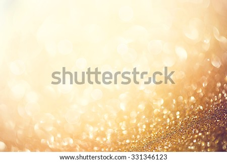 Christmas Gold Background. Golden Holiday glowing Abstract Glitter Defocused Background With Blinking Stars. Blurred Bokeh  - stock photo