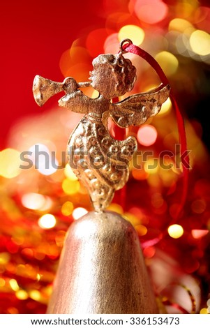 Christmas golden Angel toy playing trumpet  close-up on blurred holiday background - stock photo