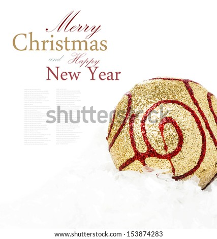 Christmas golden bauble on sbow closeup. Christmas composition (with easy removable sample text)  - stock photo