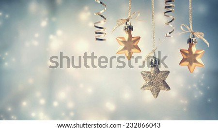 Christmas golden star ornaments in snowy night - stock photo