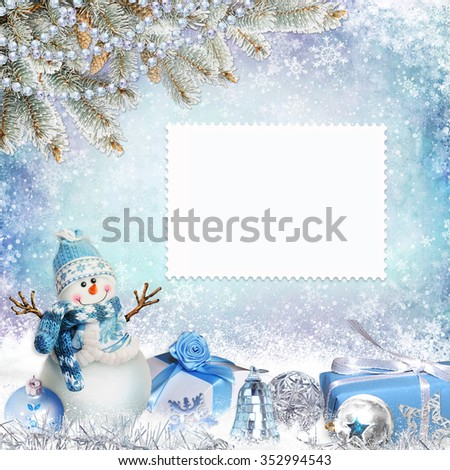 Christmas greeting background with card, pine branches, snowman and gifts  - stock photo