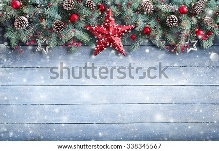 Christmas Greeting Card - Fir Branch And Decoration On Snowy Plank  - stock photo