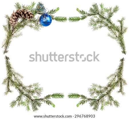 christmas greeting card frame - spruce tree branches with cones and blue ball on white background - stock photo