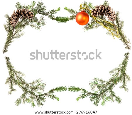 christmas greeting card frame - spruce tree branches with cones and orange ball on white background - stock photo