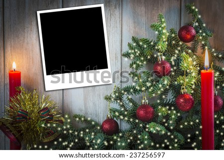 Christmas greeting card with candles and a copy space for text or photo on an old wooden background - stock photo