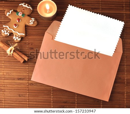 Christmas Greeting card with cookies, candle tea, cinnamon - stock photo