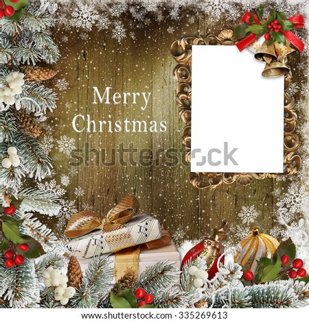 Christmas greeting card with frame, gifts, pine branches and Christmas decorations - stock photo