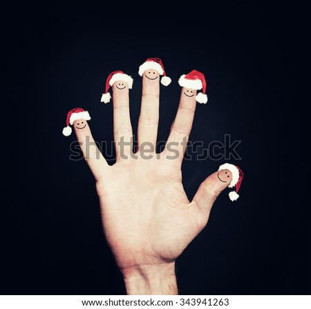 Christmas Happy Face Fingers Looking at empty Background Copy Space - stock photo