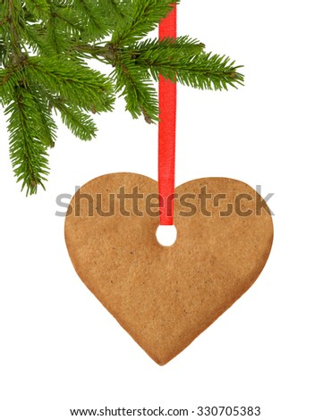 christmas heart cookie on red ribbon and christmas tree branch isolated on white background - stock photo