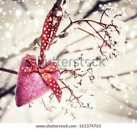 Christmas  heart decoration with snow on winter nature background - stock photo