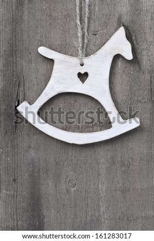 Christmas heart ornament on rustic style grunge background - stock photo