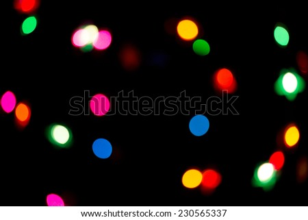 Christmas holiday background of sparkling colorful lights - stock photo