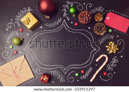 Christmas holiday background with decorations and hand drawings on chalkboard. View from above - stock photo