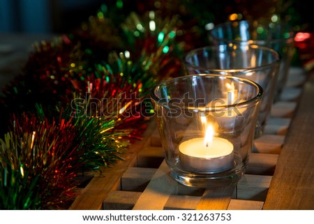 Christmas holiday background with tea candles and Christmas decorations with copyspace - stock photo