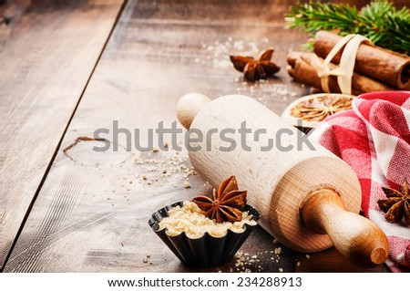 Christmas holiday baking setting with rolling pin and spices - stock photo