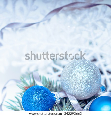 Christmas holiday decoration. Blue, white ornament bauble, snowflake with fir, pine branch background. Festive merry xmas, new year celebration. Golden shiny light  ball.  - stock photo