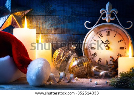 Christmas holiday eve; Christmas decoration and vintage clock - stock photo