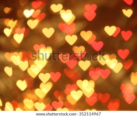 Christmas holiday lights in the shape of heart. Bokeh background. - stock photo