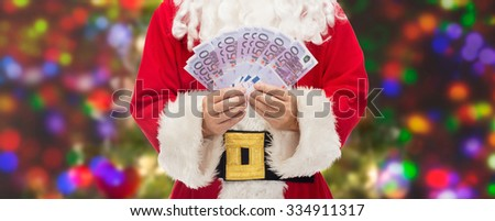christmas, holidays, winning, currency and people concept - close up of santa claus with euro money over lights background - stock photo