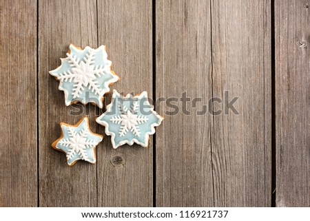 Christmas homemade gingerbread cookie over wooden table - stock photo