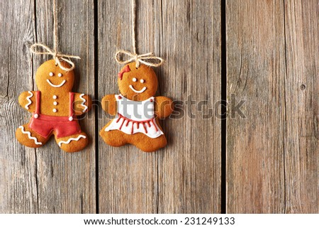 Christmas homemade gingerbread couple cookies over wooden background - stock photo