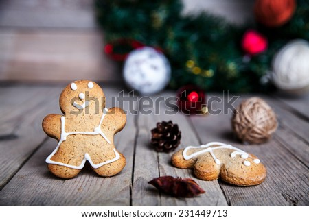 Christmas homemade gingerbread man on wooden background - stock photo