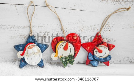 Christmas House Candle Holder Decoration with Lights in the Background - stock photo