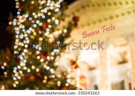 Christmas in Palermo with written Happy Holidays in italian language. the famous theater Massimo decorated with lights and Christmas tree. swirly bokeh. Palermo, Sicily - stock photo