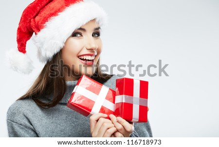 Christmas isolated woman portrait hold red christmas gift. Smiling happy girl on white background. - stock photo