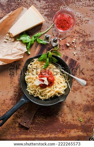 Christmas Italian pasta (spaghetti, Parmesan, wine, rose and fresh herbs) - stock photo