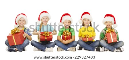 Christmas Kids, Present Gift Box, Santa Red Hat, Children Boys and Girls Happy Greeting Xmas Holiday, sitting over white background - stock photo