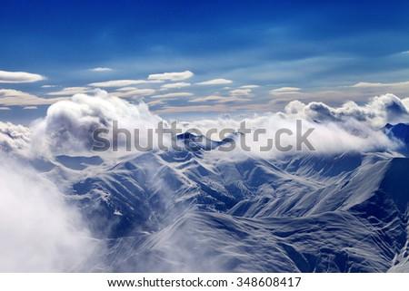 Christmas landscape with falling snow. Caucasus Mountains in evening, Georgia, region Gudauri. - stock photo