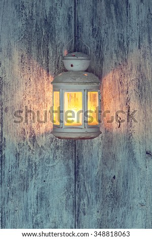Christmas lantern and snow on wooden background. Retro vintage effect. - stock photo