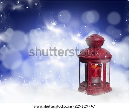 Christmas lantern on blue bokeh background - stock photo