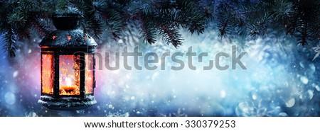 Christmas Lantern On Snow With Pine Branch  - stock photo