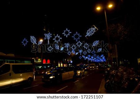 Christmas lights in Barcelona street at night - stock photo