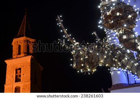 Christmas lights in town street  - stock photo