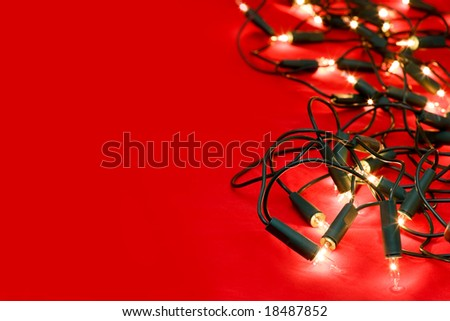 Christmas lights on red background, selective focus - stock photo